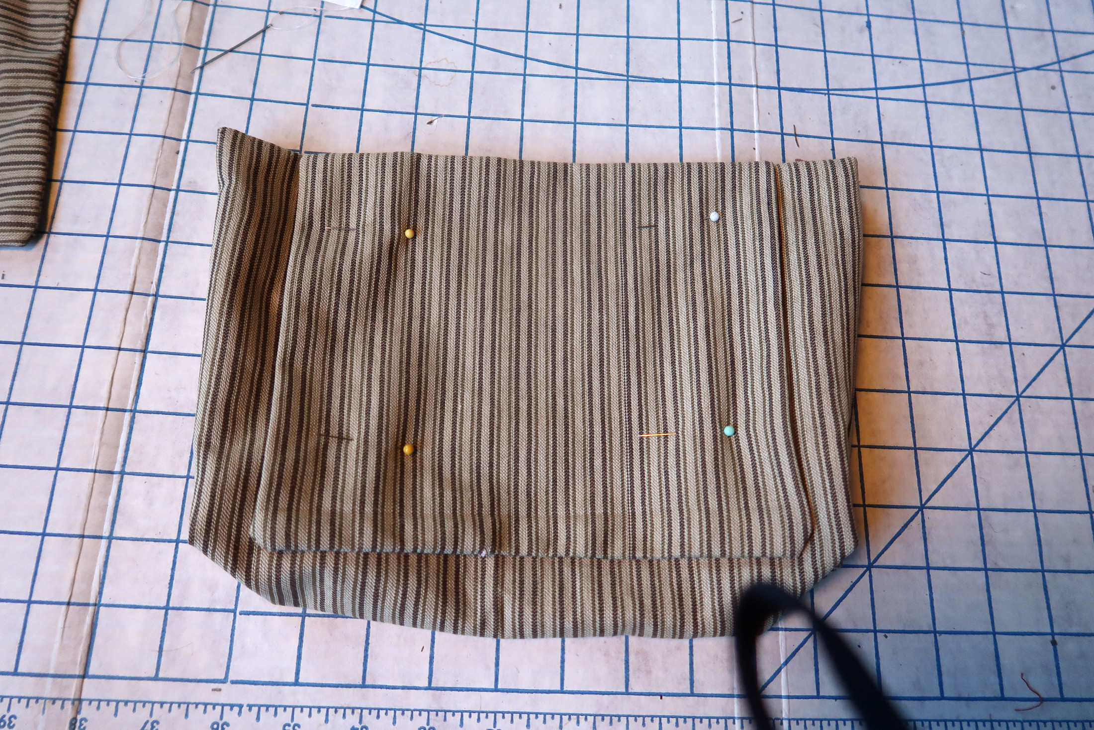 Pin backing to pouch